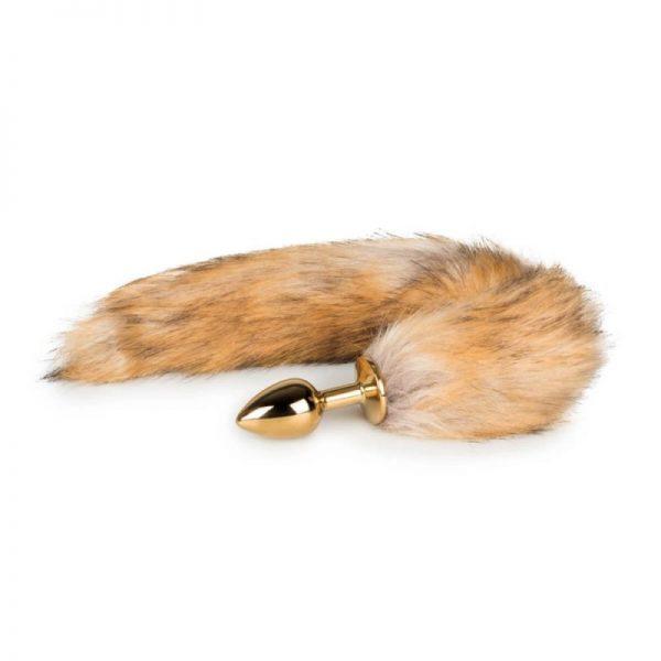 Kovový análny kolík zlatej farby s ryšavým líščím chvostom